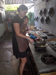 Hard at work frying up Thai food