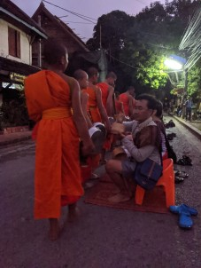 Buddhist monks getting their sticky rice at dawn